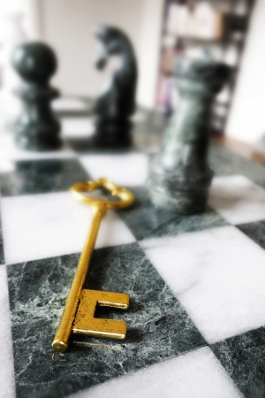 Closeup of a key on a chess board                                photo