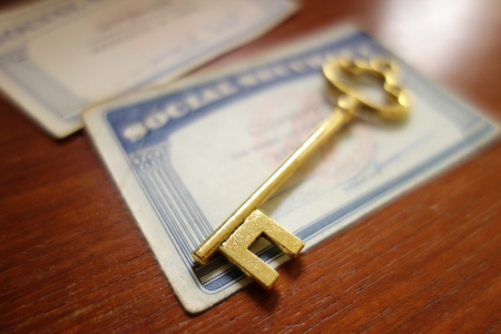 social security: Closeup of a key and Social Security cards
