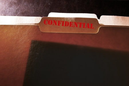 Tabbed file folder with Confidential text