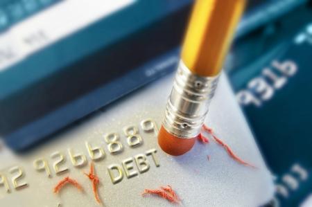 tarjeta de credito: l�piz de borrar la deuda de tarjeta de cr�dito Foto de archivo