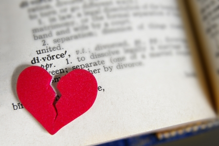 lawsuit: red broken heart on a dictionary divorce definition Stock Photo