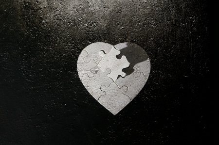 heart shaped puzzle on grunge background Stock fotó