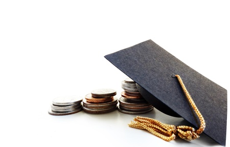 Mini graduation cap on coins, coins are sharp Stock Photo - 17613199