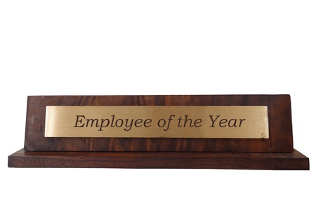 Wooden name plate, isolated on white, with Employee of the Year text                               photo