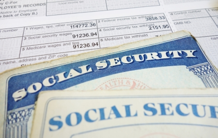 medicare: Closeup of Social Security cards and W2 wage form