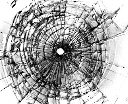 broken glass: Broken window with a bullet hole in the middle
