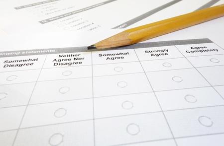 Closeup of a customer satisfaction survey and pencil                                photo