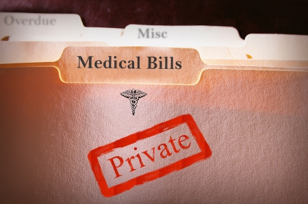 private insurance: tabbed folders with Medical Bills text  and Private stamp Stock Photo