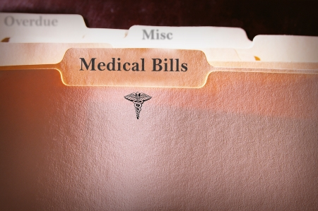 medical bills: tabbed folders with Medical Bills text and logo Stock Photo