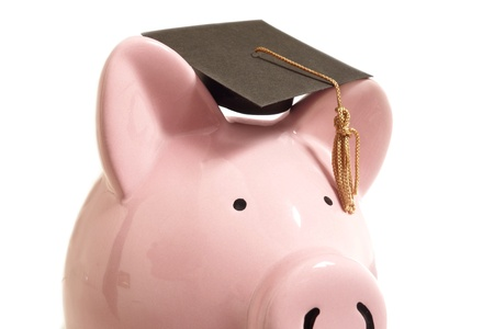 Piggy bank with a graduation cap, on white Stock Photo - 18286713
