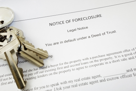 homeownership: Bank Notice of Foreclosure document and keys