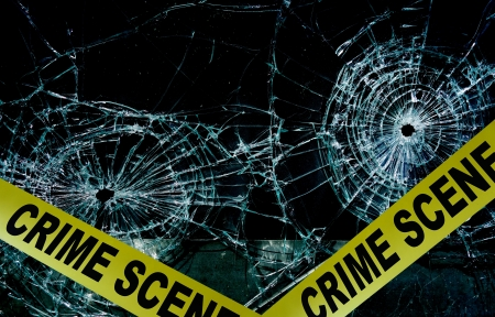 police tape: Police tape across broken glass window                                Stock Photo