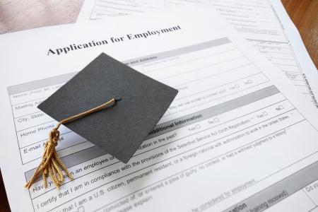 mini graduation cap on a job application form