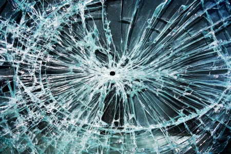 shatter: shattered glass with a hole in the middle                                Stock Photo