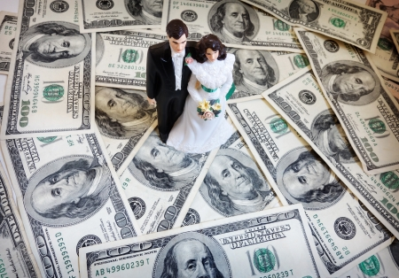 fake money: bride and groom cake-topper couple on money