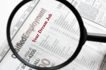 Newspaper employment section with Your Dream Job text