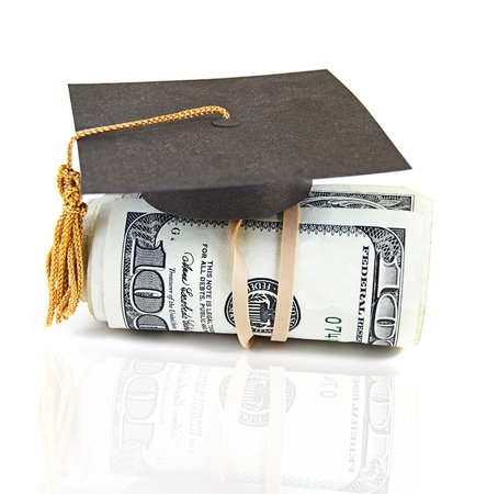 mini graduation cap on rolled up cash Stock Photo - 19841405