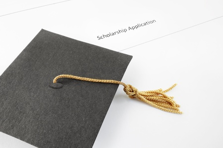 Student scholarship application and graduation cap                                photo