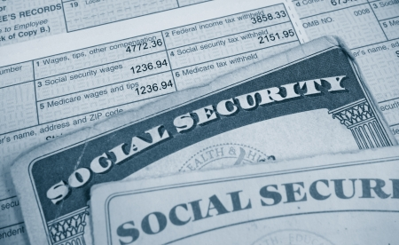 medicare: W2 tax form and Social Security cards                                Stock Photo
