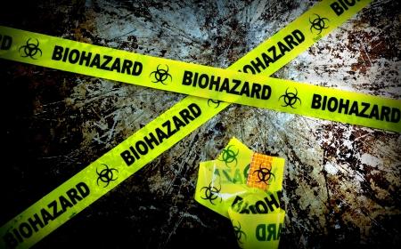 bio hazard: yellow biohazard tape on grunge background