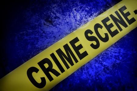 escena del crimen: cinta de la escena del crimen amarillo sobre fondo azul con textura