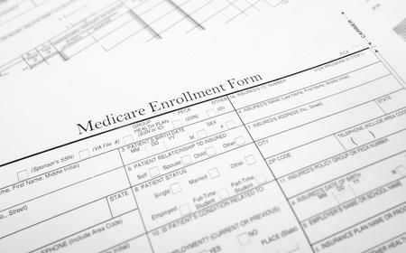 enrollment: Closeup of a Medicare enrollment healthcare form                                Stock Photo