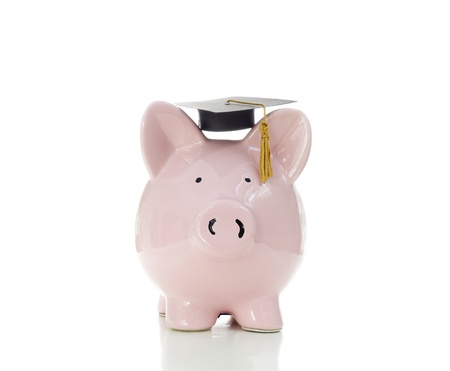 piggy bank wearing a graduation cap, on white                                Stock Photo - 20787309