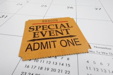 closeup of a Special Event ticket stub on a calendar                                photo