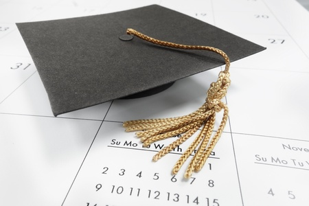 scholarship: Closeup of graduation cap on a calendar                               Stock Photo