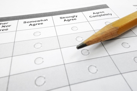closeup of a survey questionnaire form and pencil                                photo