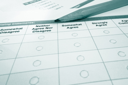 Closeup of a customer satisfaction survey and pencil                                photo