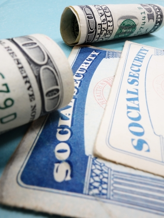 Social Security cards and cash bills                               photo