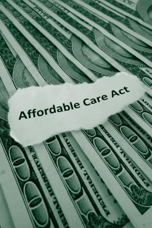 クローズ アップの手頃な価格の医療法、別名 Obamacare テキストお金を