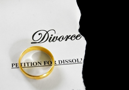 decree: torn divorce decree with gold wedding ring