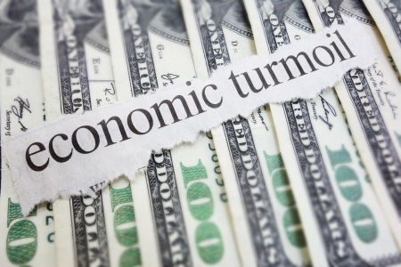 turmoil: Economic Turmoil newspaper headline on cash                                Stock Photo