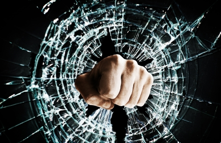 window: Fist punching thru a glass window