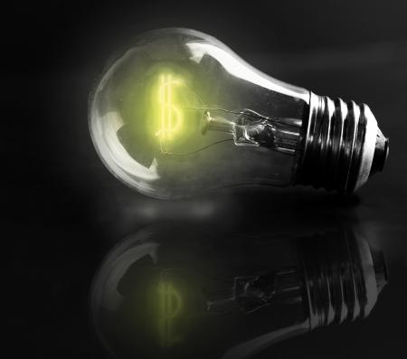 utilities: light-bulb dollar sign  energy costs  Stock Photo