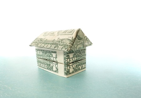 Origami house made out of dollar bills                                photo