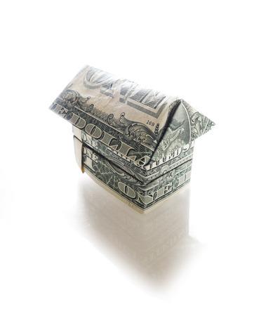 Origami dollar house, isolated on white background