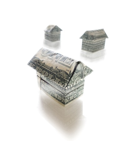 Paper origami homes made out of dollar bills