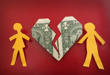 couple arguing: paper couple on broken dollar heart                                 Stock Photo