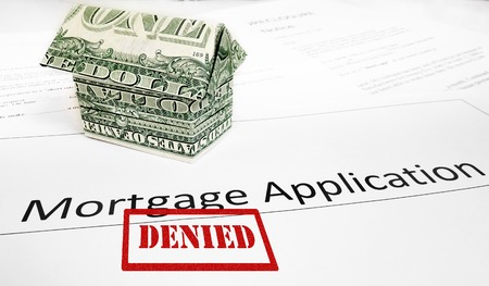 denied: A Denied mortgage application with an origami dollar house
