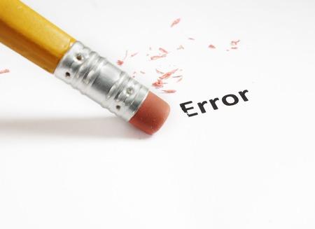 correction: closeup of a pencil eraser fixing an  error                                 Stock Photo