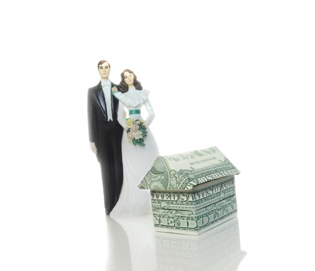 bride and groom cake topper couple and mini money house                                photo