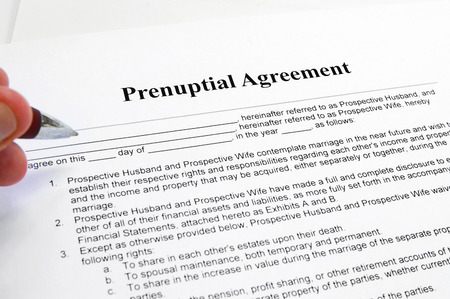 signing a prenuptial marriage contract Stock Photo - 25455553