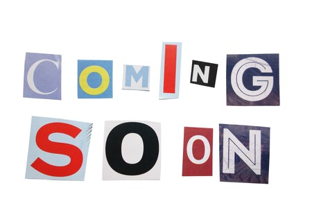 Coming Soon text in cutout paper letters, isolated on white