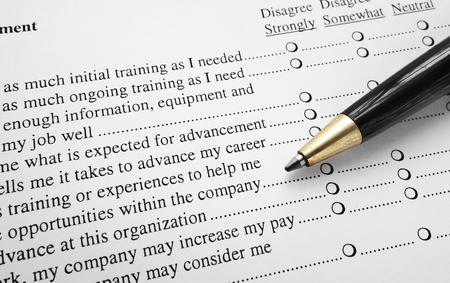 Closeup of an employee survey with pen                                photo