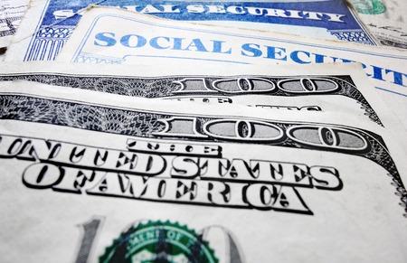 Closeup of Social Security cards and money                                photo