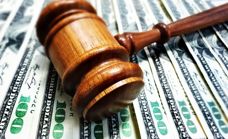 sue: A court gavel on 100 bills - legal concept                                Stock Photo