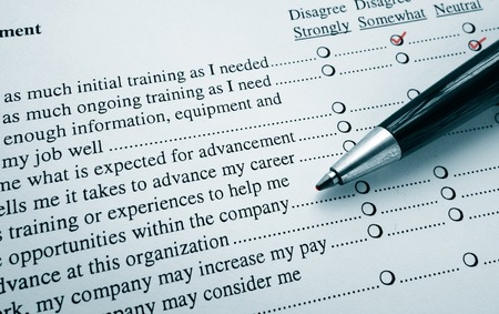 Closeup of an employee survey with red pen marks